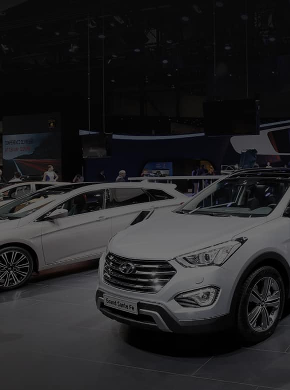 Side- front view of grand santa fe exhibited and people are walking around the motorshow