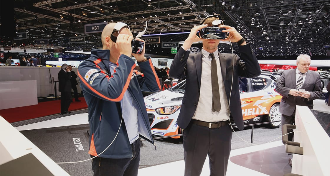 Two visitors wearing head mount display experiencing VR at the motorshow