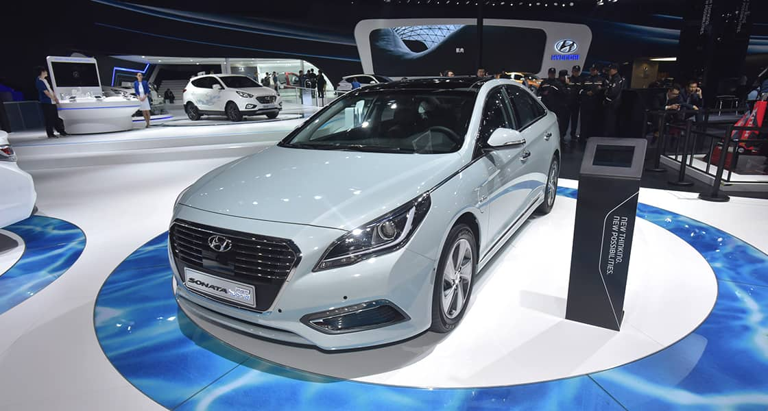 Front side view of sonata hybrid exhibited with standing display screen