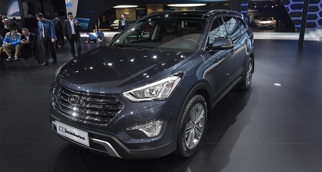 Left side-front view of dark gray Santa Fe exhibited