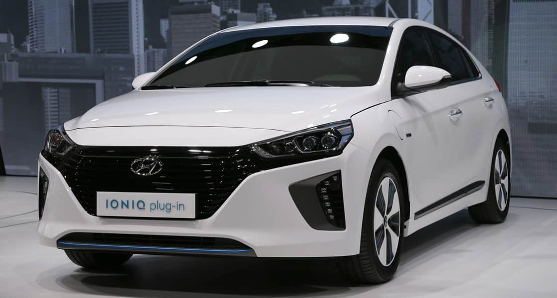 Left side-front view of white IONIQ plug-in exhibited at the 2016 Geneva motorshow