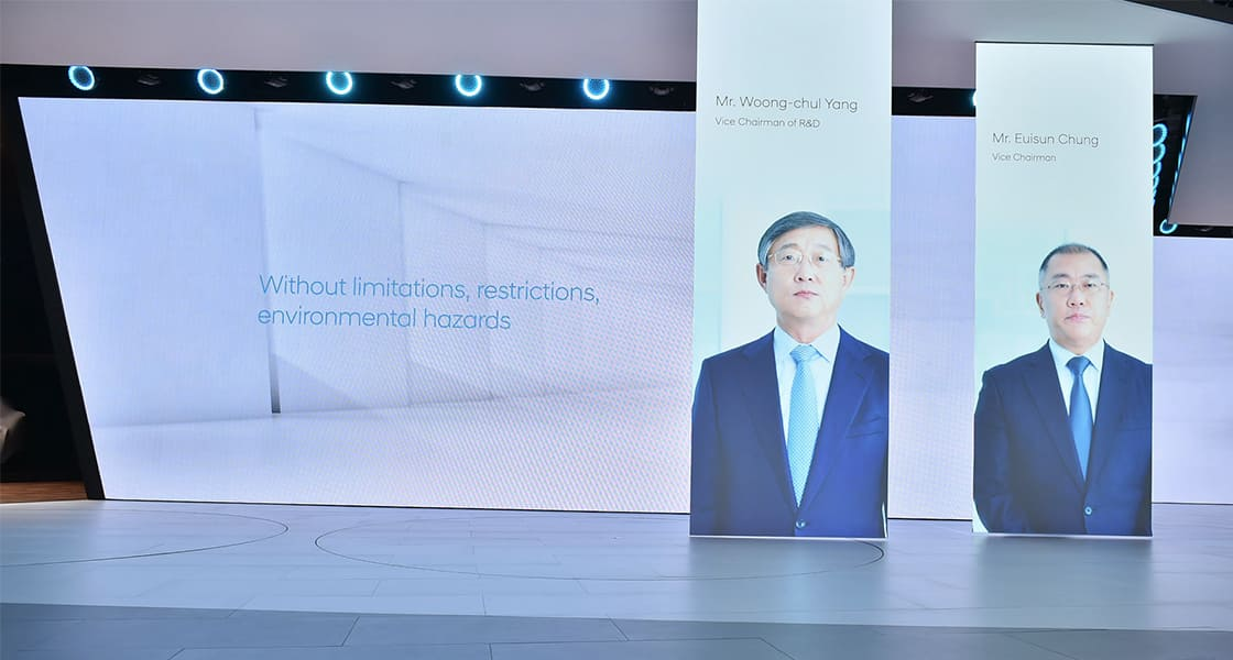 Members of Hyundai motors company presented on the horizontal banners at the stage