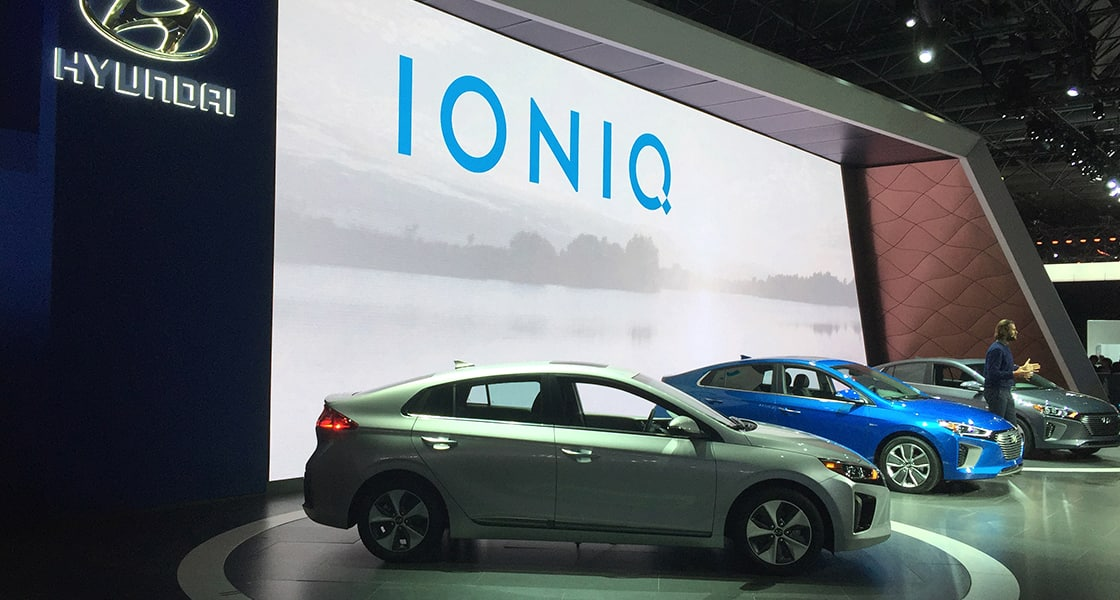 Side view of three Ioniqs exhibited at the stage