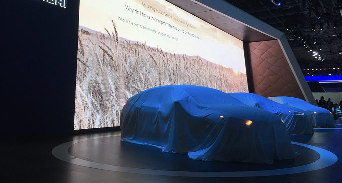 The car veiled with blue fabric at the stage