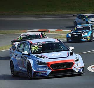 right side front view of i30 n tcr on a race track