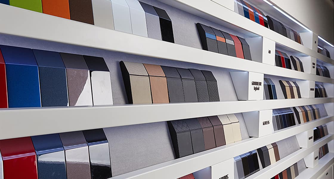 Exterior and Interior material panels displayed on the wall by vehicle models