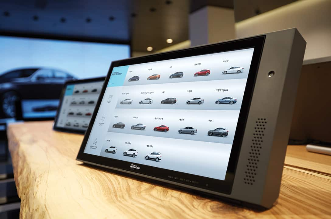 Tablet PC screen showing list of Hyundai vehicles on the table