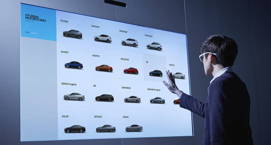 Visitor selecting a vehicle on the touchable display on the wall