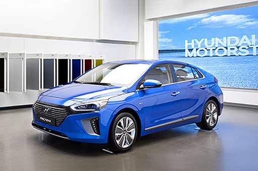 Blue Ioniq exhibited in front of exterior panels