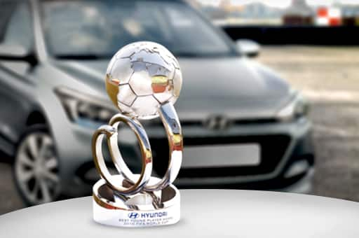 A trophy of Hyundai Best Young Player Award displayed in front of hyundai motors car as a background