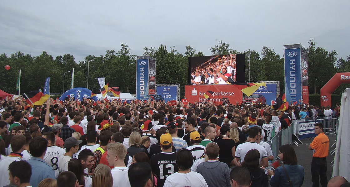 A crowd of fans enjoying game broadcasted at Hyundai Fan Park Heilbronn
