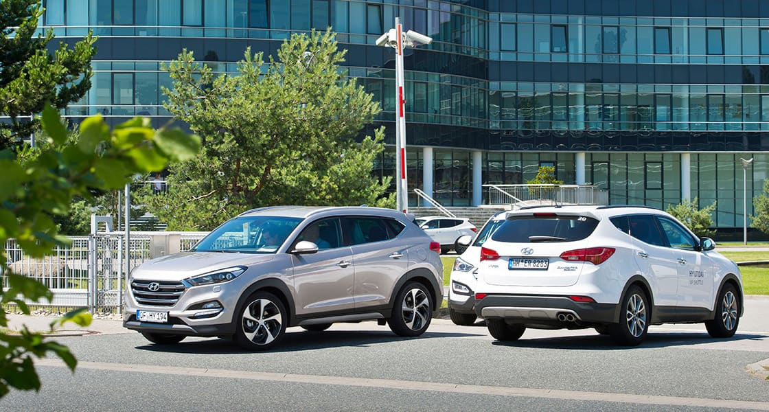 All New Tucson driving in and out of test-drive parking lot