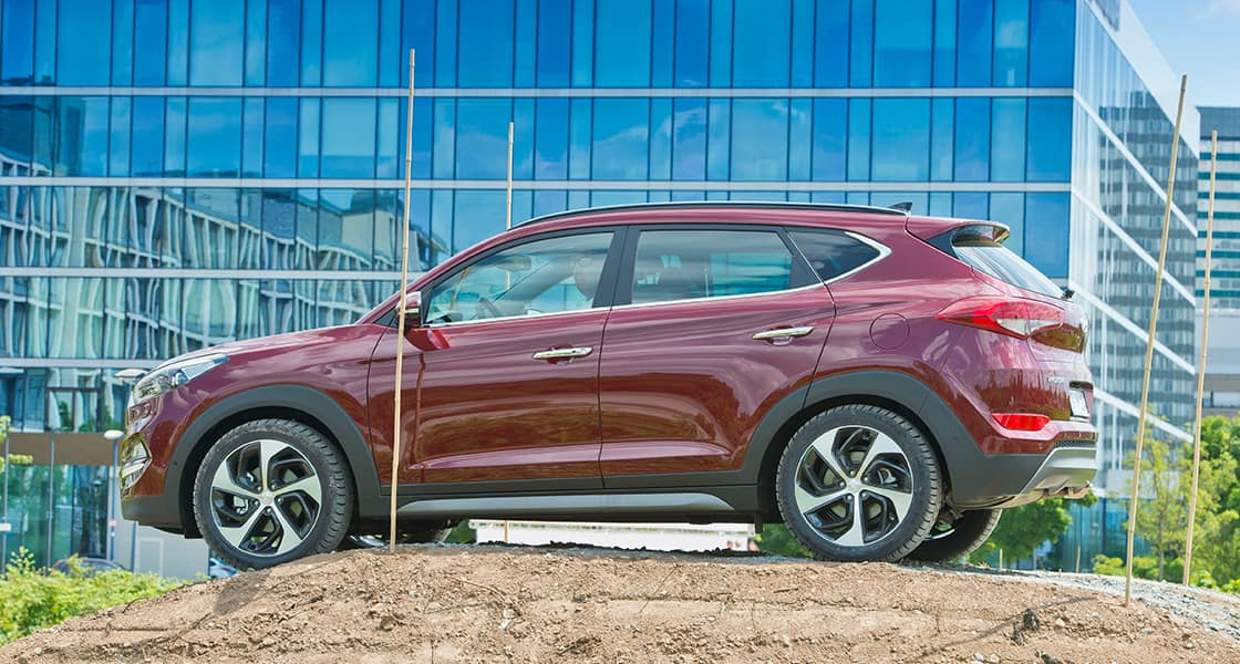 Left side view of burgundy Tucson