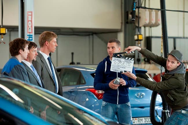 Lukas Podolski receives a ceremonial key to his new Hyundai ix35